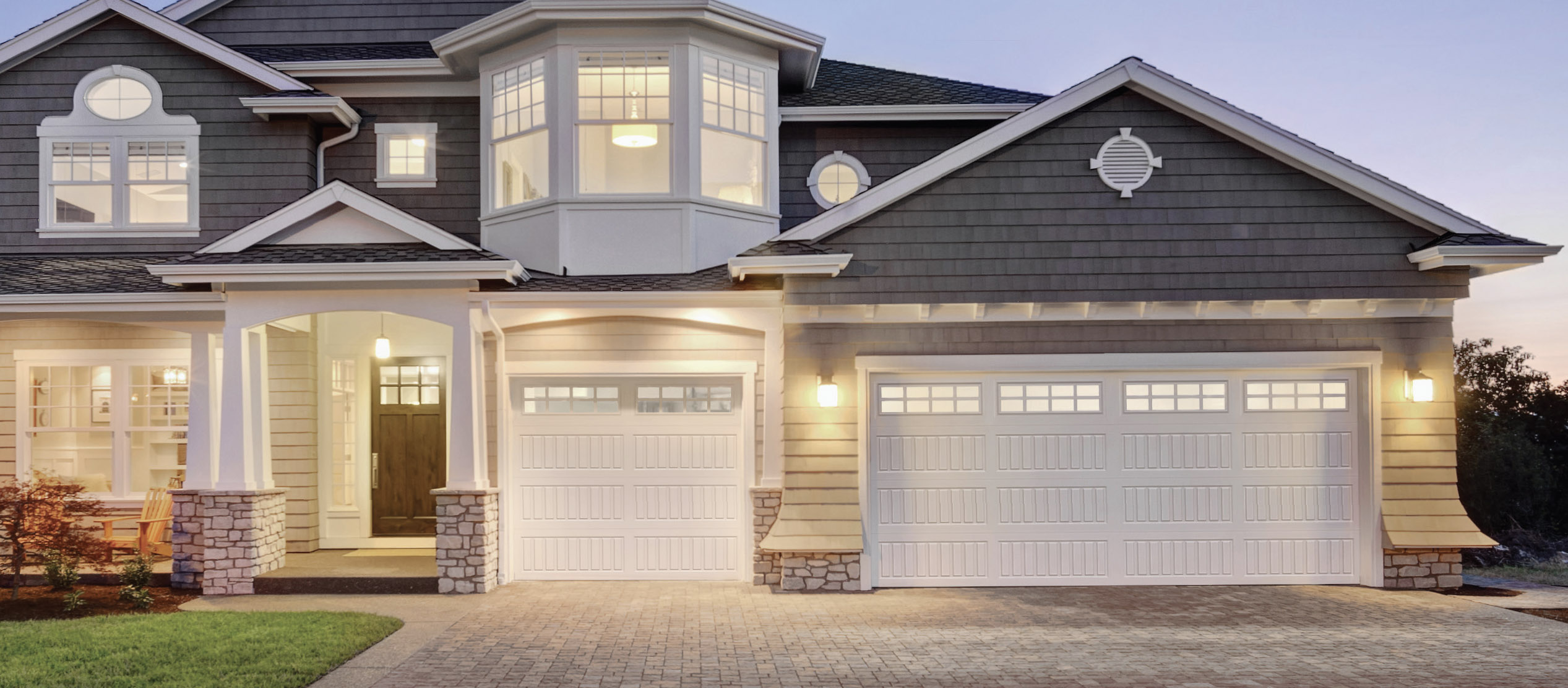 Home With Long Panel Carriage Garage Doors